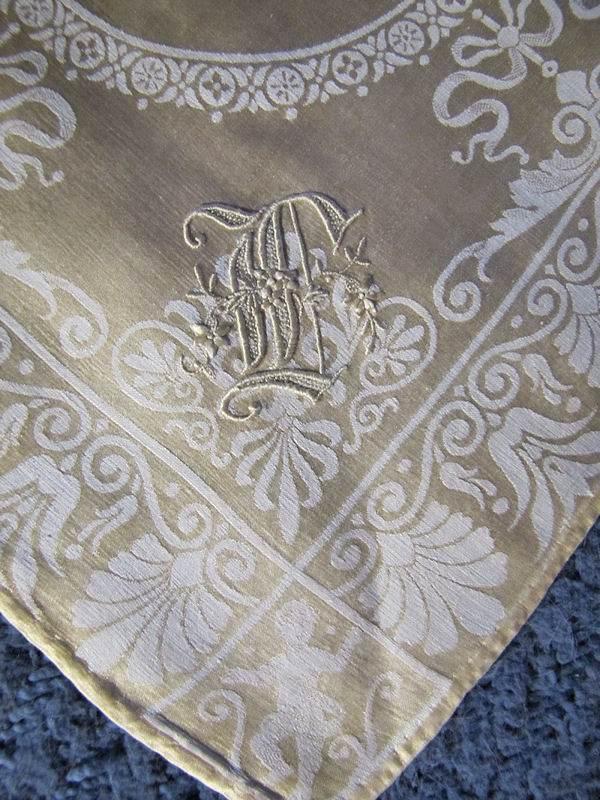 close up vintage antique napkins figural damask