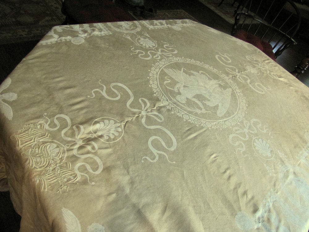 close up vintage antique figural damask tablecloth