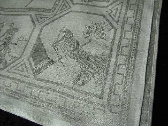 close up vintage figural damask tablecloth
