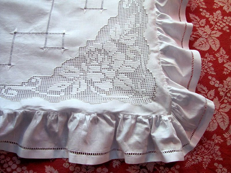 close up pair of vintage handmade button-back pillow shams with ruffle, lace and embroidery