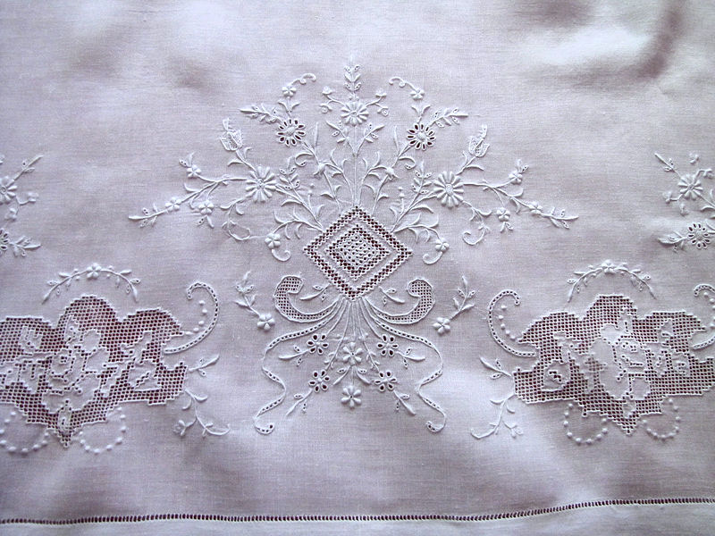 close up vintage antique pair layover pillow shams with handmade lace and whitework embroidery