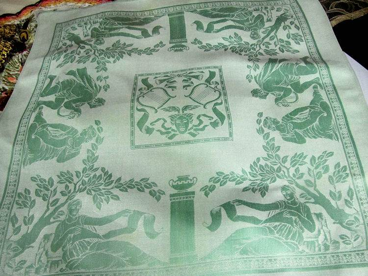 a napkin matching figural damask tablecloth