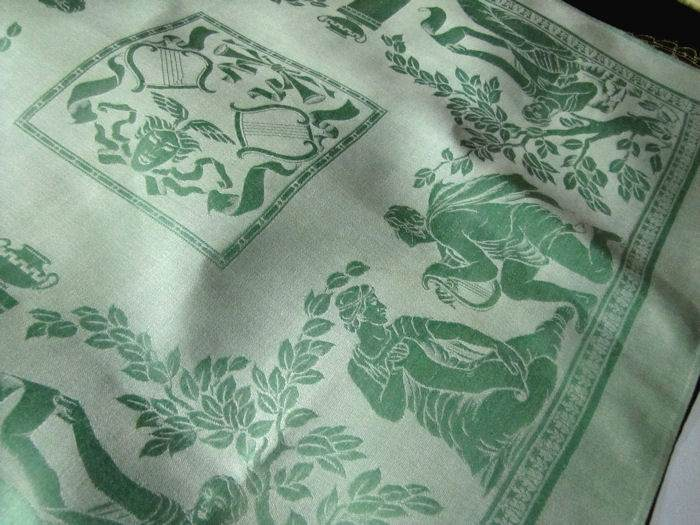 center of napkin matching figural damask tablecloth