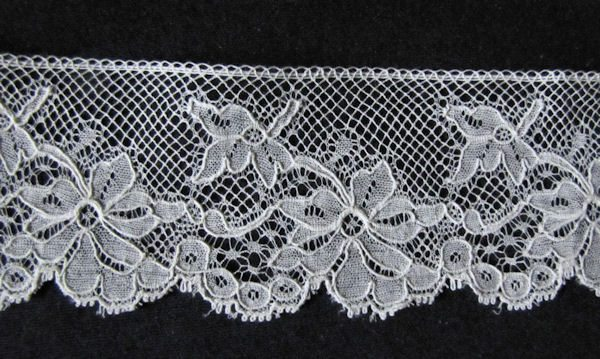 close up antique vintage alencon lace trim