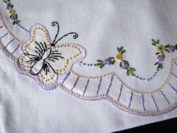 close up vintage antique lingerie folder or bag hand embroidered butterflies