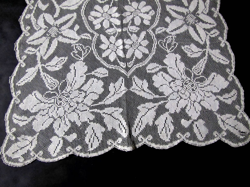 close up vintage antique table runner handmade lace