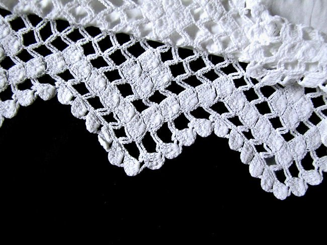 close up handmade lace on pair vintage pillowcases