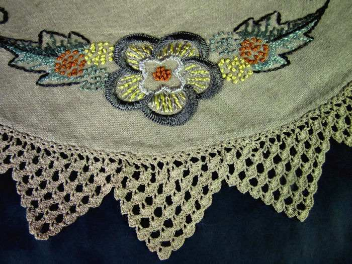close up vintage antique linen table topper with handmade lace and silk embroidery