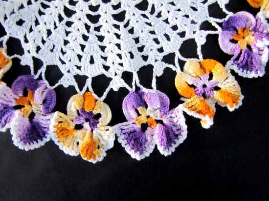 close up vintage handmade figural lace doily with pansies