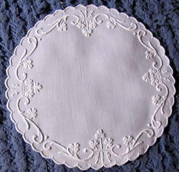 close up pair vintage doilies white linen handmade whitework Irish shamrocks