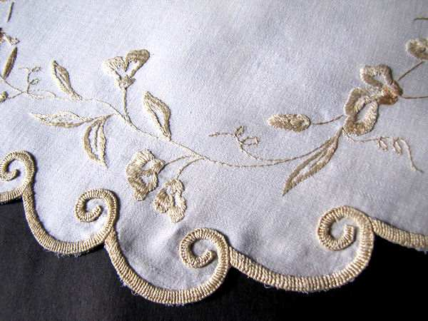 close up vintage antique society silk embroidered linen doily