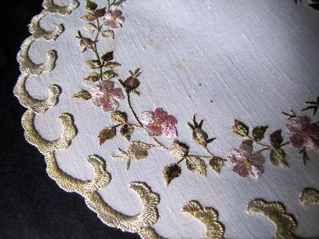 close up vintage antique white linen doily with society silk embroidery
