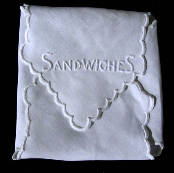 close up vintage white linen sandwich cover hand embroidered