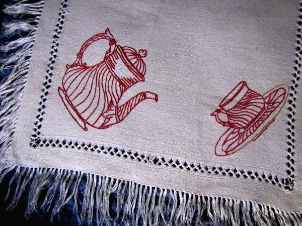 close up vintage table runner dresser scarf with redwork teapots