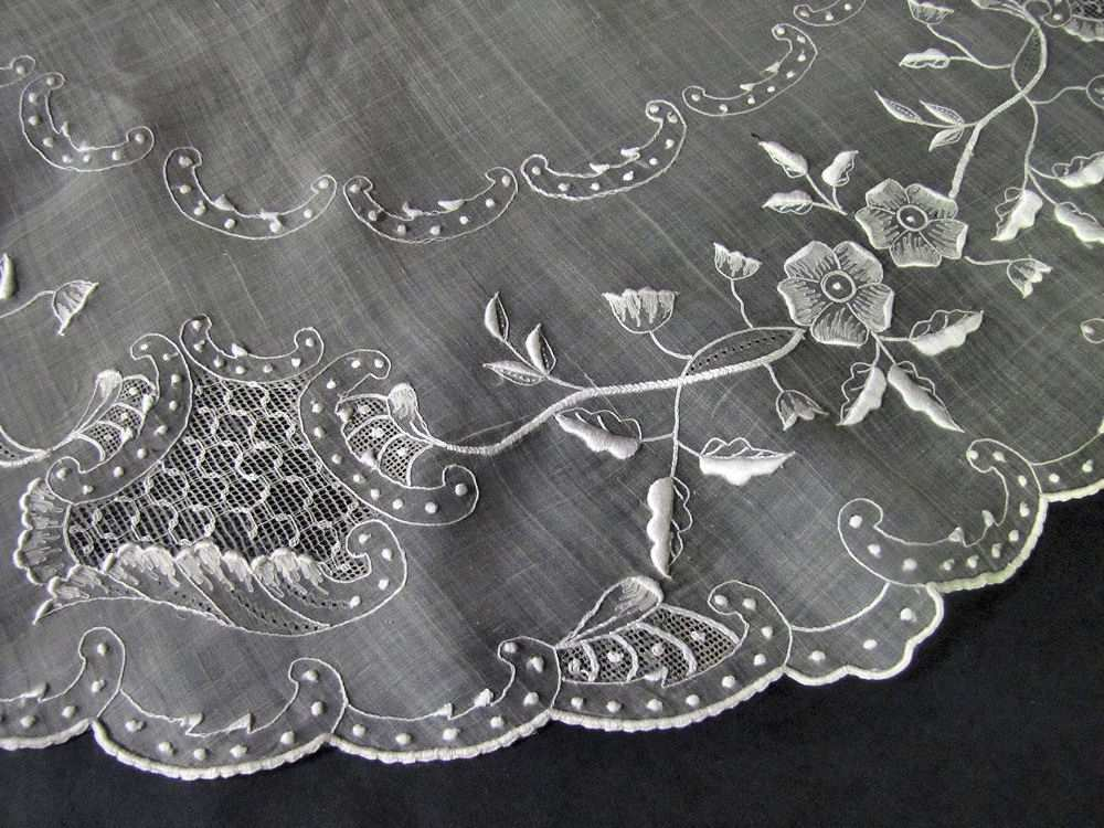 close up vintage antique table topper sheer organdy hand embroidery