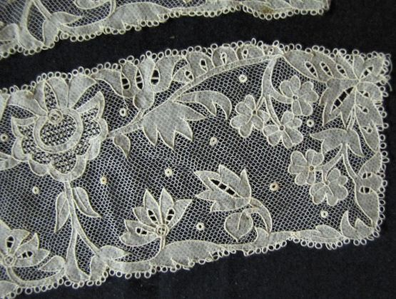 close-up antique victorian carrickmacross lace cuffs