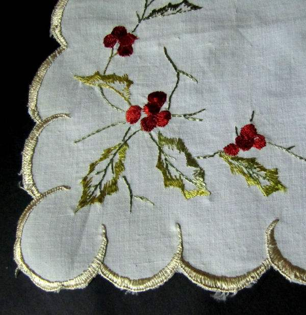 close up vintage half round linen doily with society silk embroidery