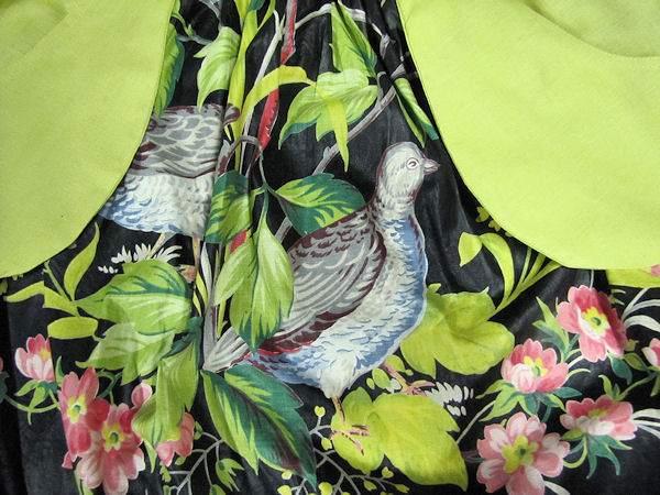 vintage apron close up of bird on black chintz
