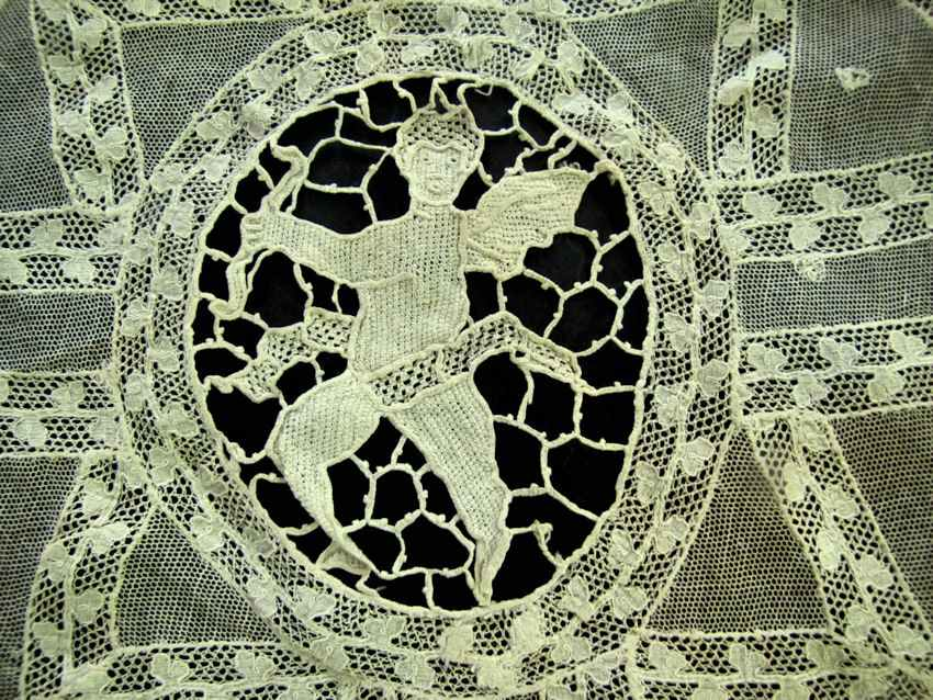 close up vintage antique Normandy and Figural Lace doily