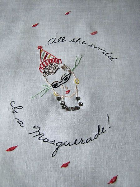 vintage white linen towel with masquerade figure