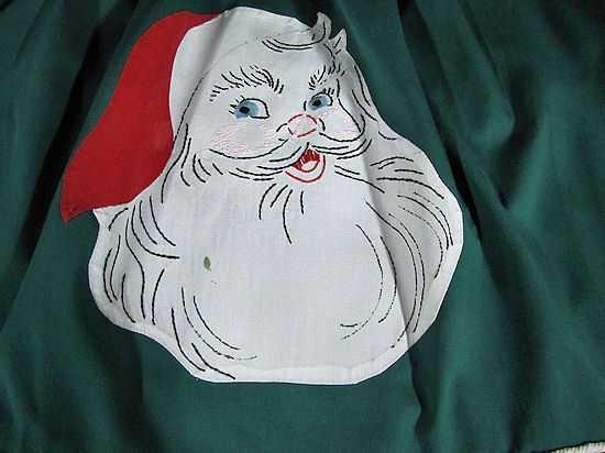 close up vintage handmade Christmas Santa Claus apron