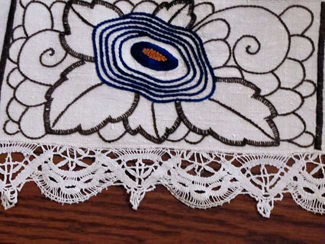close up vintage antique linen tablecloth with handmade lace and art deco embroidery