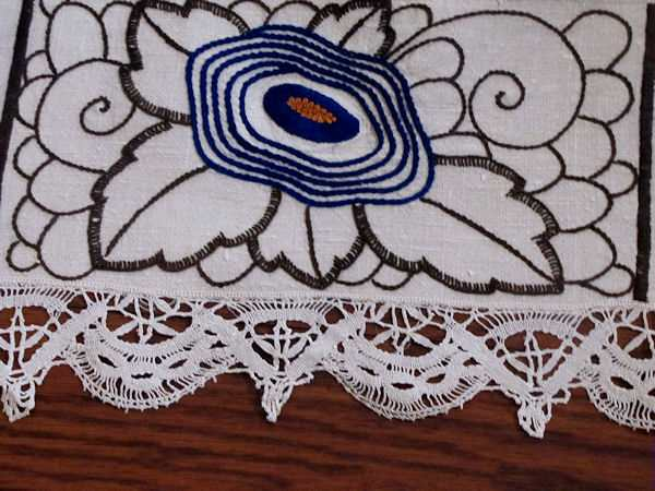 close up 3 vintage antique linen tablecloth with handmade lace and art deco embroidery