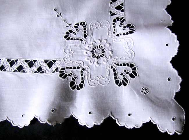 close up vintage antique white linen table topper with handmade lace and whitework