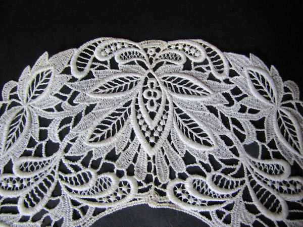 close up vintage lace collar with original tag