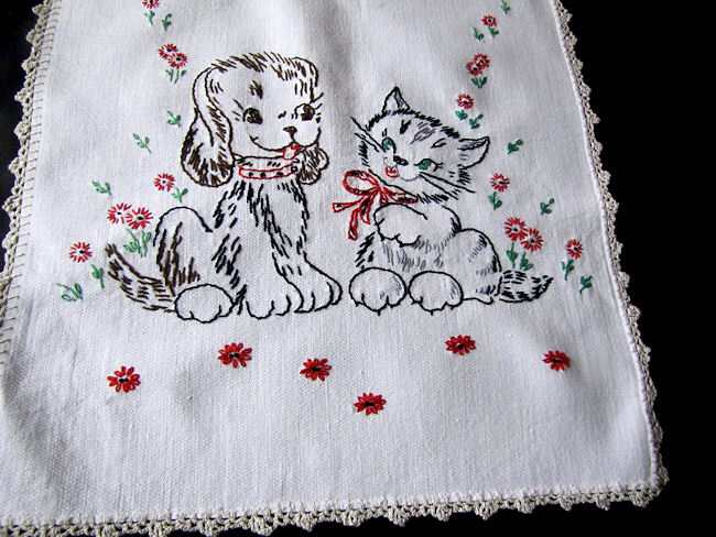 close up vintage antique table runner dresser scarf hand embroidered puppy and kitten