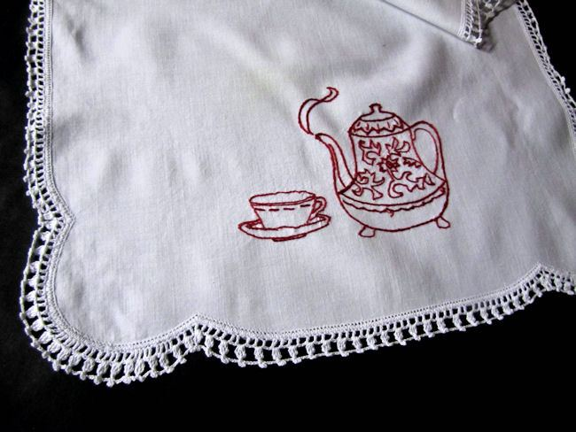 close up vintage antique table runner dresser scarf redwork tea pot