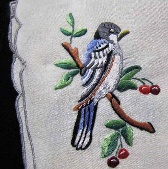 close up vintage antique placemats set hand embroidered birds
