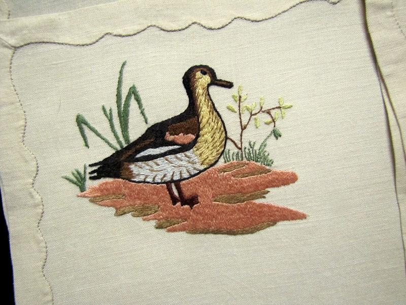 close up vintage antique placemats set linen with hand embroidered birds