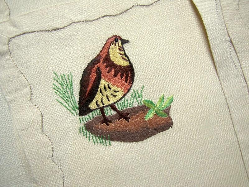 close up 2 vintage antique placemats set linen with hand embroidered birds