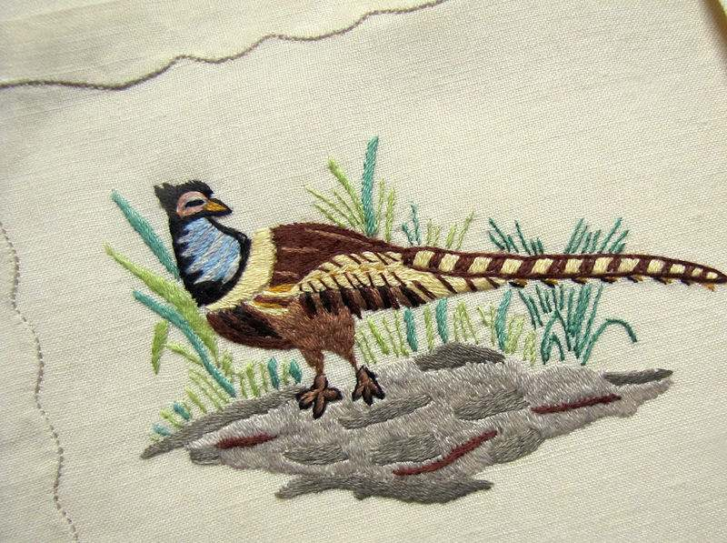 close up 3 vintage antique placemats set linen with hand embroidered birds