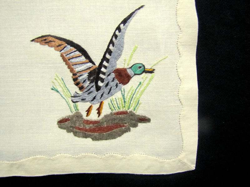 close up 6 vintage antique placemats set linen with hand embroidered birds