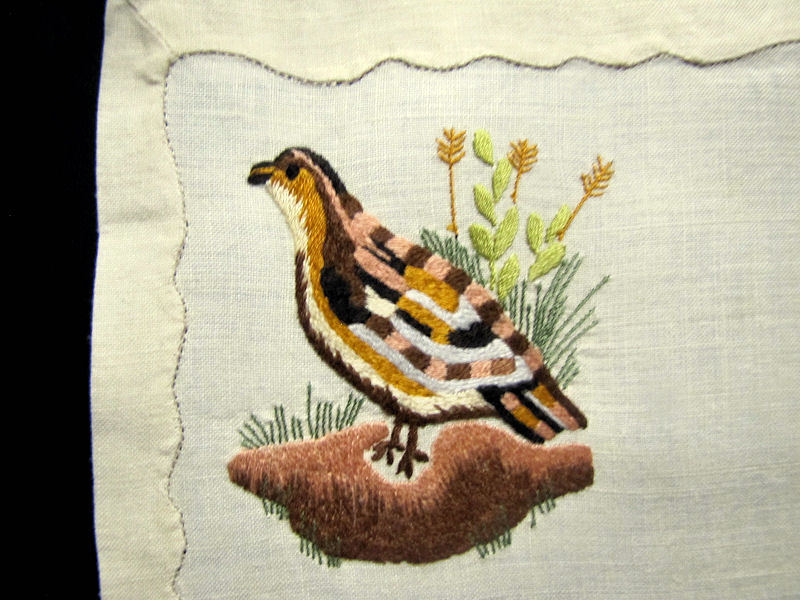 close up 7 vintage antique placemats set linen with hand embroidered birds