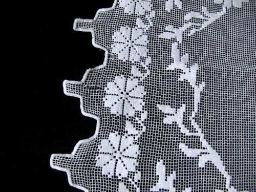 pulled threads figural lace table topper