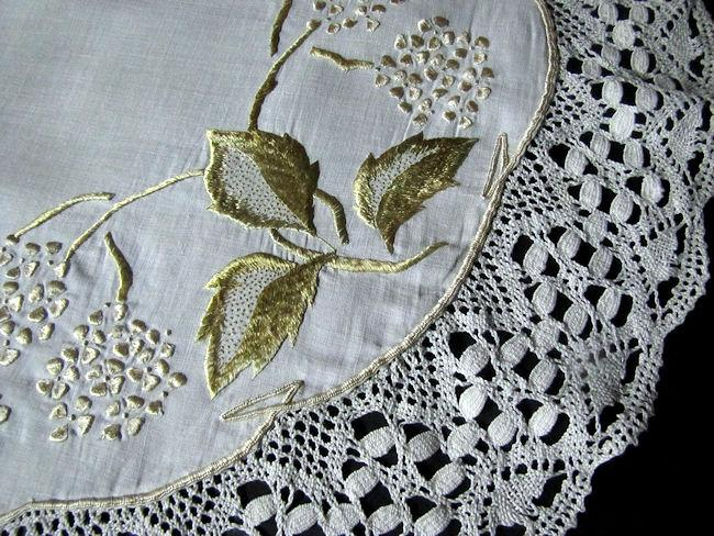 close up vintage antique linen handmade table topper with society silk embroidery and lace edge