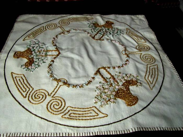 vintage table topper with hand embroidered flower baskets