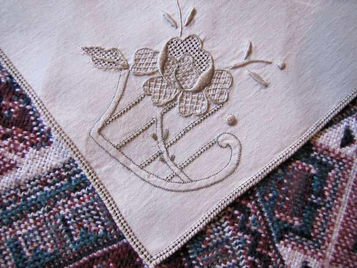 close up vintage antique linen embroidered napkins