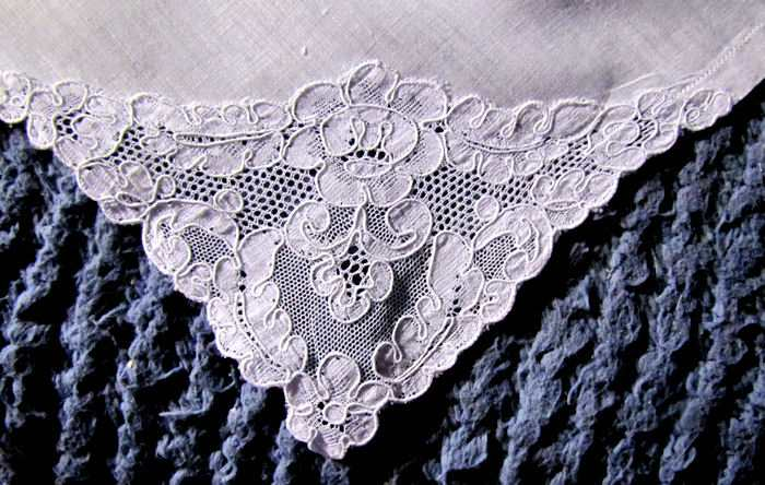 close up vintage antique napkins white linen Alencon lace