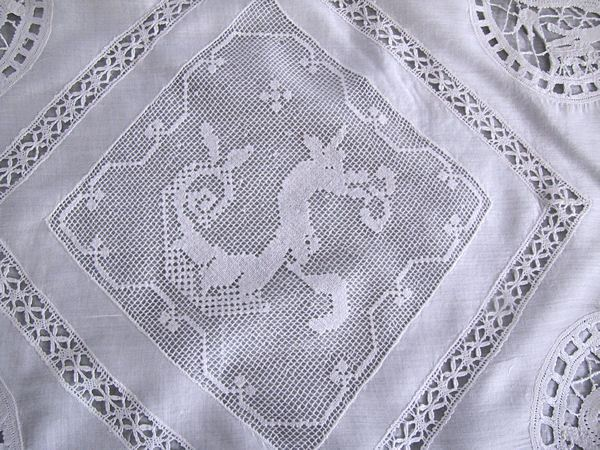 center of antique handmade figural lace pillow cover
