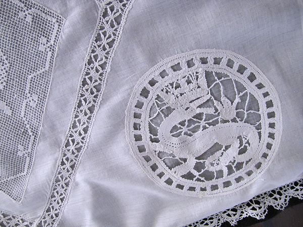 one corner of antique figural lace pillow cover