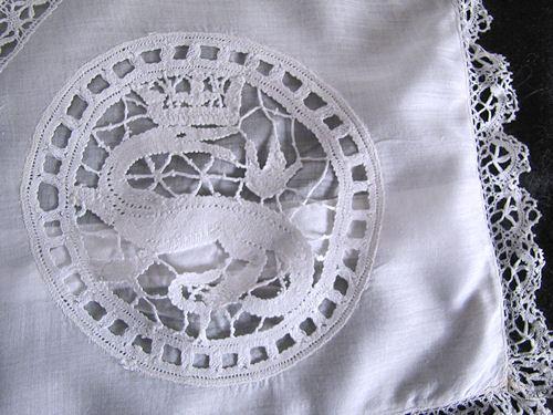 close up corner figural bobbin lace on antique pillow cover