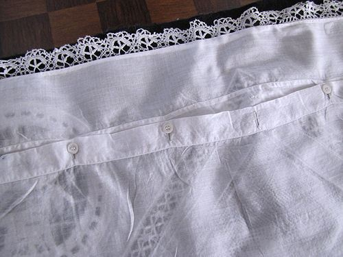buttons on antique handmade figural lace pillow cover