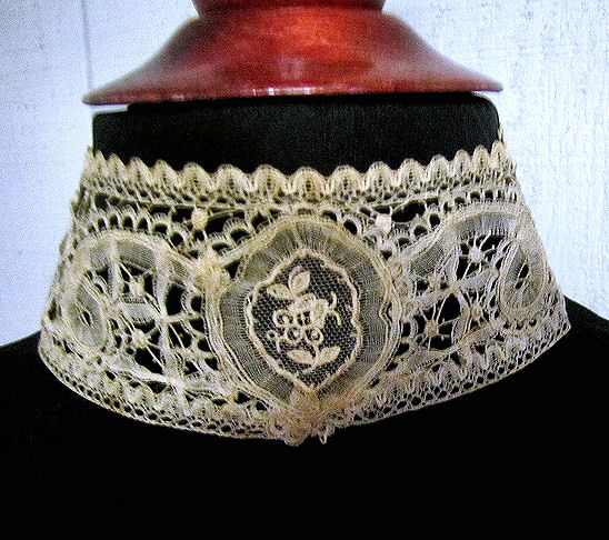 close up Victorian antique handmade Brussels lace high collar