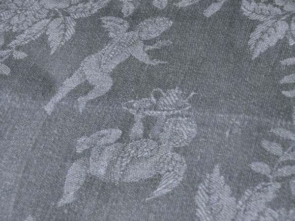 vintage napkins linen damask close up figures of cherubs