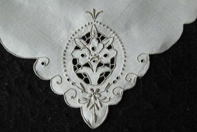 close up handmade lace on vintage linen dinner napkins