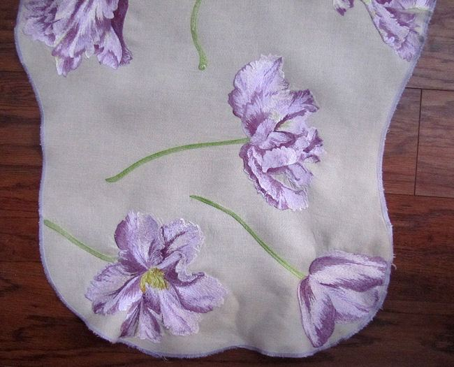 close-up purple flowers on vintage table runner dresser scarf